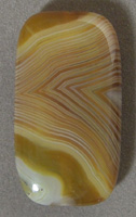Rectangle pendant bead from yellow brown and white Queensland agate.