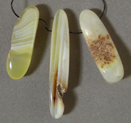 Three freeform beads from Queensland agate.