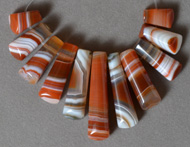 Trapezoid shaped beads from red and white agate.