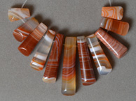 11 graduated trapezoid beads from red and white agate.
