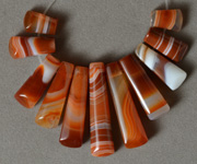 Red and white agate graduated trapezoid beads.