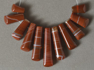 11 brown agate graduated trapezoid shaped beads.