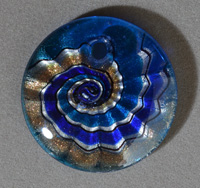 Round pendant bead from lampwork glass.