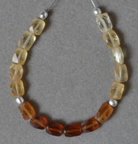 Small finely faceted Hessonite garnet beads.