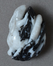 Zebra agate pendant bead carving of rabbit.