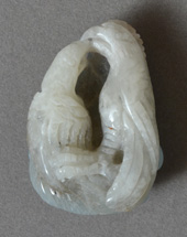 White opal carving of two birds with amazonite back.