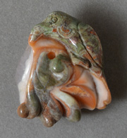 Pendant bead bird carving from multi color agate from Idaho.