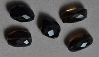 Faceted nugget beads from smoky quartz.