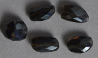 Five faceted nugget beads from smoky quartz.