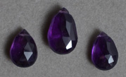 Three faceted amethyst drop beads.