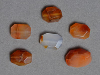Faceted oval beads from carnelian.
