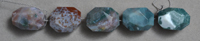 Faceted nugget beads from multi color Indian moss agate.
