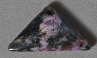 Triangle shaped charoite pendant bead.