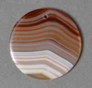 Pendant bead from cream, rust and brown agate.