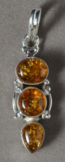 Baltic amber pendant with silver bale.