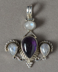 Amethyst and moonstone pendant with siver bale.