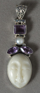 Sterling silver pendant with amethyst and carved bone.