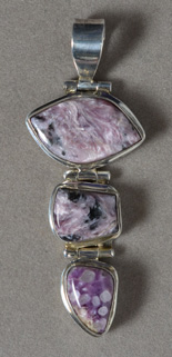 Russian charoite pendant with sterling silver bale.