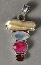 Blister shell, rainbow moonstone, ruby and garnet pendant.