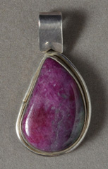 Silver pendant with ruby cabochon.