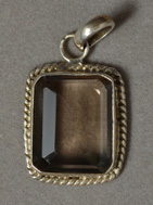 Pendant from faceted smoky quartz with silver bezel.