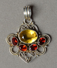 Citrine with silver gemstone pendant.