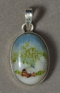 Pendant with log cabin cameo scene.