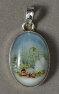 Pendant with painted log cabin cameo scene.