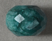 Large emerald faceted rondelle bead.