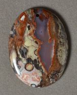 Spider web agate flat oval pendant bead.