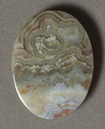 Crazy lace agate flat oval pendant bead.