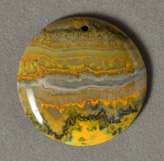 Yellow band opal flat round bead.