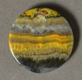 Yellow banded opal round pendant bead.