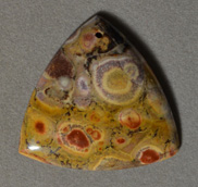 Poppy jasper rounded triangle shaped pendant bead.