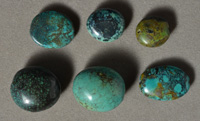 Assorted turquoise oval beads.