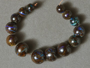 Graduated round beads from Australian boulder opal.