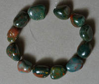 Tumbled nugget beads from heliotrope bloodstone.