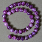 Strand of unusual round beads from sugilite.