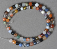 6mm round beads from several gemstone varieties.