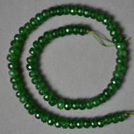 Faceted rondelle beads from emerald green chalcedony.