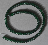 6mm rondelle beads from green jade.
