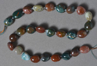 Polished multi-color agate nugget beads.