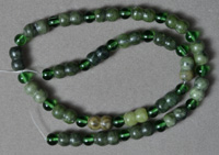 Peanut shape serpentine with 6mm round green glass beads.