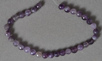 Different shades of amethyst 6mm faceted rounds.