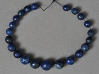 Graduated sized lapis with pyrite faceted round beads.
