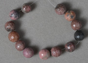 Rhodonite 10mm faceted round beads