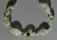 Prehnite barrel beads  with star spacers.