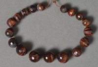 Tiger eye micro faceted graduated round beads.