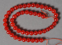 Micro faceted ruby colored jade round beads.