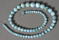 Strand of blue larimar round beads in graduated sizes.
